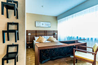 Bed in room Superior Trio