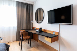 superior room desk and television in scandic espoo finland