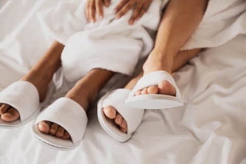 feet with slippers in bed at scandic hotels