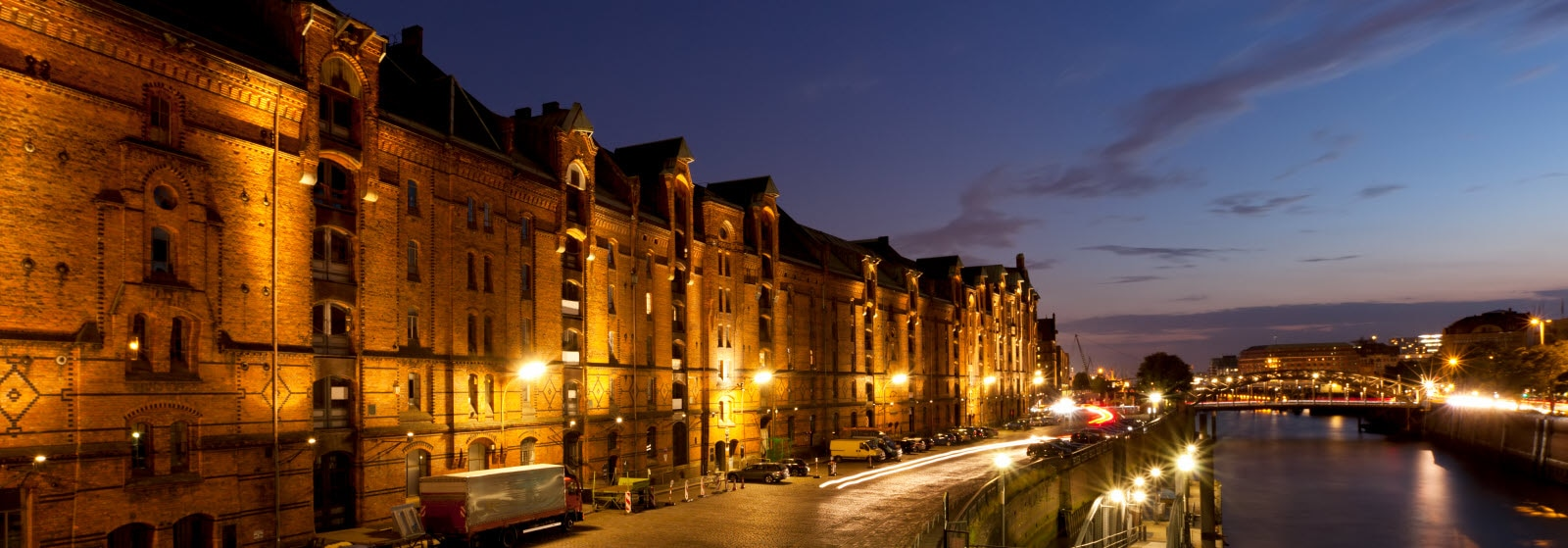 Hamburg, ancient warehouse district Speicherstadt at dusk. Photo: Mostphotos.com