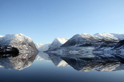 Lake reflection of Jølstravatn in Norway once in winterly February