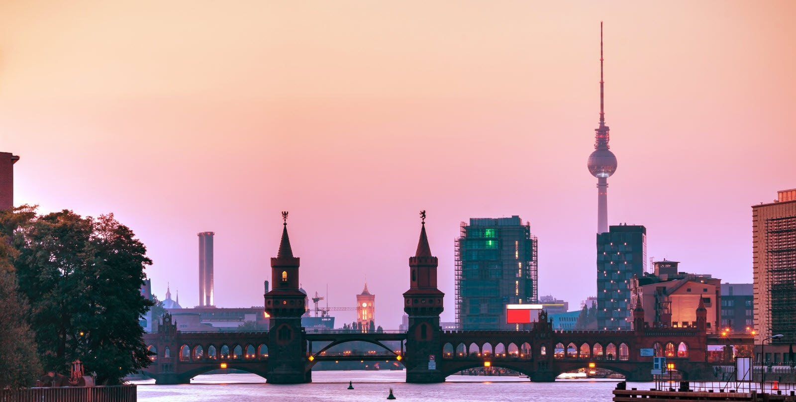 Berlin cityscape with Oberbaum bridge in the evening