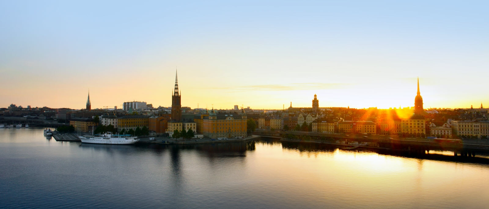 View over Stockholm city, sunrise over Riddarfjarden and the colours are bright and yellow.