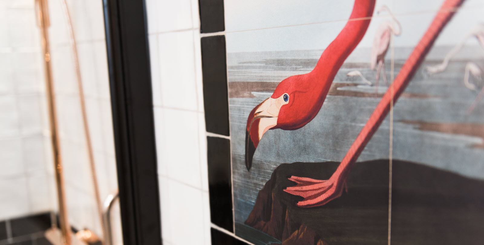 Interior decoration in the bathroom. Picture on the wall, flamingo.